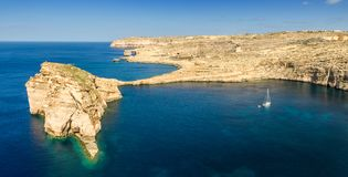 Gozo, Malta - Panoramic view of the beautiful Fungus rock with t. He Azure Window and sail boat at Dwejra bay on a beautiful summer day with clear blue sky Stock Photography