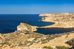 Gozo, Malta - Panoramic view of the famous Azure Window. With the Fungus rock and Dwejra bay on a beautiful summer day with clear blue sky Royalty Free Stock Images