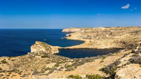 Gozo, Malta - Panoramic view of the famous Azure Window with the. Fungus rock and Dwejra bay on a beautiful summer day with clear blue sky Stock Image