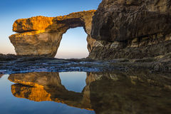 Gozo, Malta - Sunrise at the beautiful Azure Window. A natural arch and famous landmark on the island of Gozo with reflection. It`s been collapsed on 9th of Royalty Free Stock Image