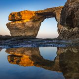 Gozo, Malta - Sunriseat the beautiful Azure Window with reflection. Gozo, Malta - Sunriseat the beautiful Azure Window, a natural arch and famous landmark on the Royalty Free Stock Photography