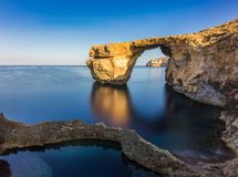 Gozo, Malta - Sunriseat the beautiful Azure Window. A natural arch and famous landmark on the island of Gozo with reflection. It`s been collapsed on 9th of Stock Photos