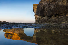 Gozo, Malta - Sunriseat the beautiful Azure Window. A natural arch and famous landmark on the island of Gozo with reflection. It`s been collapsed on 9th of Royalty Free Stock Photos