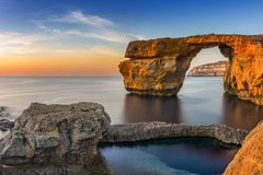 Gozo, Malta - Sunset at the beautiful Azure Window. A natural arch and famous landmark on the island of Gozo Stock Photo
