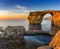 Gozo, Malta - Sunset at the beautiful Azure Window. A natural arch and famous landmark on the island of Gozo Stock Photography