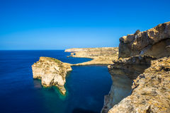 Gozo, Malta - Tha beautiful Fungus Rock on the Island of Gozo. With the Azure window at background and clear blue sky Royalty Free Stock Image