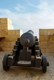 Gozo, Rabat, cannon in castle with cloudy sky Stock Photo