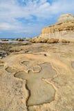 Gozo, rocky beach Malta. Rocky beach in Gozo, Malta. Xwejni Bay with view for lunar hill Stock Photos