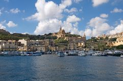 Gozo: Scenic landscape of Mgarr Harbour, Malta. Scenic, beautiful landscape of Mgarr Harbour at Gozo Island, Malta. On the hill above the port is the city of Royalty Free Stock Image
