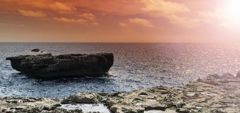 Rugged coastline of Gozo. Gozo is a small island of the Maltese archipelago in the Mediterranean Sea.  Rugged coastline delineated by sheer limestone cliffs, and Stock Photo