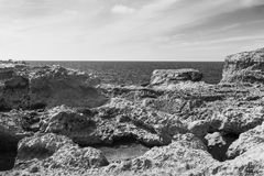 Rugged coastline of island of Gozo. Gozo is a small island of the Maltese archipelago in the Mediterranean Sea.  Rugged coastline delineated by sheer limestone Royalty Free Stock Images