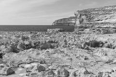 Rugged coastline of island of Gozo. Gozo is a small island of the Maltese archipelago in the Mediterranean Sea.  Rugged coastline delineated by sheer limestone Stock Image