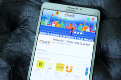 Gozocabs inter city taxi app. Downloading gozocabs inter city taxi app from google play store on samsung tablet. Gozo provides one-way inter-city AC Cabs all Royalty Free Stock Photos