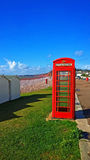 GPO Phone box. BT GPO red telephone box on a beach, public use call payphone Taken OCT 2014 on exmouth beach, devon, uk Stock Photos