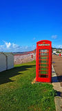GPO Phone box. BT GPO red telephone box on a beach, public use call payphone Taken OCT 2014 on exmouth beach, devon, uk Stock Images