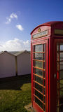 GPO Phonebox. BT GPO red telephone box on a beach, public use call payphone Taken OCT 2014 on exmouth beach, devon, uk Royalty Free Stock Photography