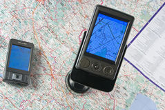 Gps. Ppc with function of the navigator close up against a map Royalty Free Stock Photo