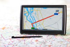 Gps. A gps navigator and map Royalty Free Stock Photography