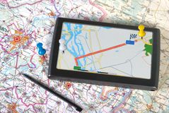 Gps. A gps navigator and map Royalty Free Stock Images