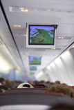 GPS on board. A tv screen with gps signal on plane Stock Images