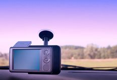GPS - In The Car. Pocket PC with GPS module attached to the windscreen stock photo