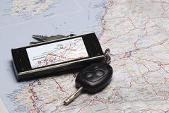 A GPS and the car keys on a map. Stock Images