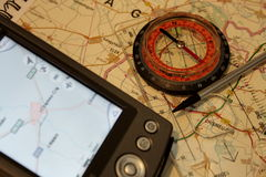 GPS and classic compass concept. Using Global Positioning System and classic compass together for acquiring best position Stock Photos