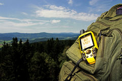 GPS climbing. A backpack with GPS Stock Image