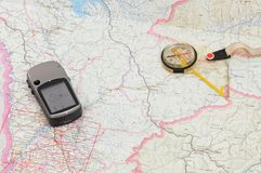 GPS and Compass on Map. Compass, GPS and Map for planning a hiking trip Royalty Free Stock Photography