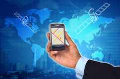 GPS con il telefono astuto Fotografie Stock