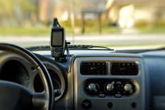 GPS on dashboard. Modern GPS unit mounted on automobile dashboad. Selective focus stock image