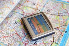 GPS device. Map and global position system navigation device Royalty Free Stock Photos