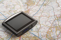 GPS device on a map Royalty Free Stock Photos