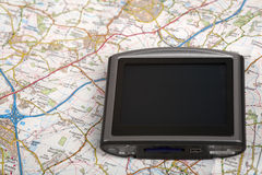 GPS device on a map. GPS unit seated on a road map Stock Photo