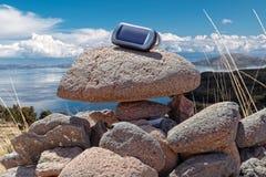 Gps device on rocks Royalty Free Stock Photography