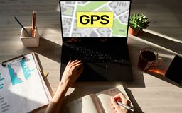 GPS Global Positioning System, Worldwide navigation and tracking concept with town maps on screen. royalty free stock photo