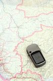 GPS and Map. GPS on map for planning trip for camping, hiking or driving Stock Photos