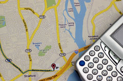 GPS and Map. Old and new technology side by side Royalty Free Stock Photo