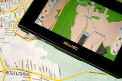 GPS and map. A GPS mobile (navigation device) and old traditional map Royalty Free Stock Photography