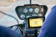 GPS map screen helicopter. GPS map screen inside helicopter with control panel out of focus in background Stock Photo