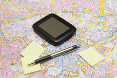 GPS on a Map with Sticker and Pen. Closed GPS on a Map with Sticker and Pen stock image