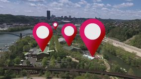 GPS markers on an aerial city. Simulated GPS location markers are placed on businesses in a city`s suburbs stock footage