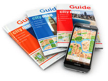 GPS mobile phone navigation  and travel guide books. Stock Photos