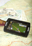Gps navigation. Gps device for navigation, map, passport, money and clock Royalty Free Stock Images