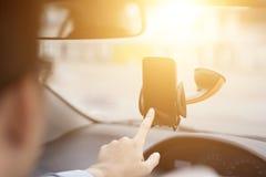 GPS Navigation. Close-up of Businessman Hand Using GPS Navigation Inside Car Stock Photography