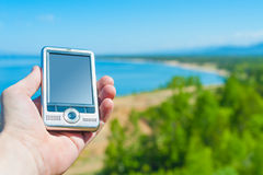GPS navigation device in hand Royalty Free Stock Photography
