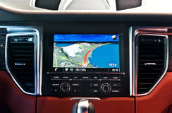 GPS navigation in interior of luxury car Stock Images