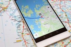 GPS navigation map smartphone. Modern smartphone with navigation system. Classical map vs. GPS navigation application in smartphone Royalty Free Stock Images
