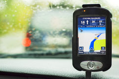 GPS navigation receiver. An electronic GPS navigation device on an auto dashboard Stock Images