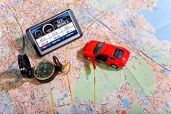 GPS Navigation system on a traveling map Stock Photography
